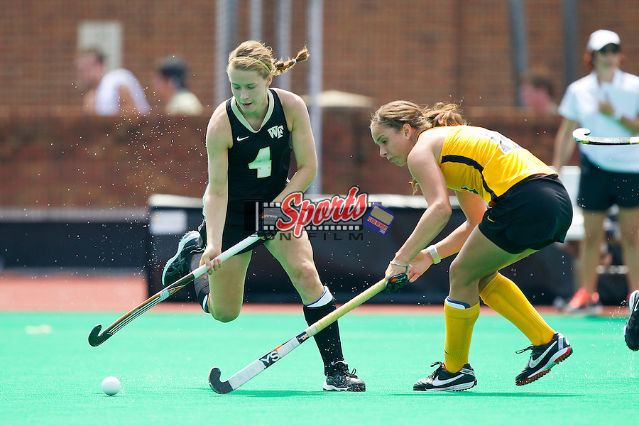 Christine Conroe (4) of the Wake Forest Demon Deacons pursues the ball during first half action against the Iowa Hawkeyes at Kentner Stadium on August 25, 2012 in Winston-Salem, North Carolina.  The Hawkeyes defeated the Demon Deacons 3-2 in overtime.  (Brian Westerholt / Sports On Film)