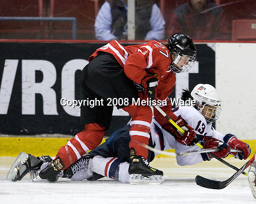 Gina Kingsbury (Canada - 27), Julie Chu (US - 13) - Team USA defeated Team Canada 4-3 (so) to win the 2008 Four Nations Cup on Sunday, November 9, 2008, in the 1980 Rink in Lake Placid, New York.