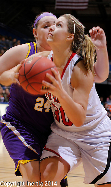 SIOUX FALLS, SD - MARCH 9:  Margaret McCloud #30 of USD drives past Marley Hall #24 of Western Illinois during their quarterfinal game at the 2014 Summit League Basketball Championships at the Sioux Falls Arena Sunday. (Photo by Dick Carlson/Inertia)