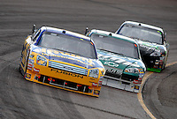 Nov. 9, 2008; Avondale, AZ, USA; NASCAR Sprint Cup Series driver Jamie McMurray (26) leads a pack of cars during the Checker Auto Parts 500 at Phoenix International Raceway. Mandatory Credit: Mark J. Rebilas-