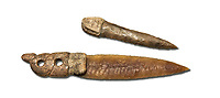 Brown obsidian dagger with a bone handle carved into the shape of a snake. It is believed this may have been a ritual dagger. Catalhoyuk Collections. Museum of Anatolian Civilisations, Ankara. Against a white background