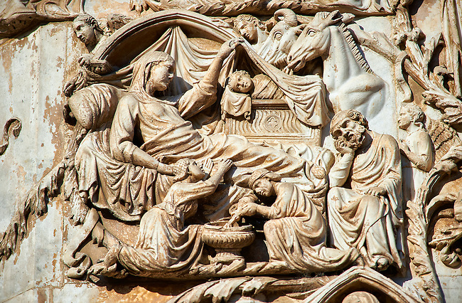 Bas-relief sculpture panel scene of the Nativity by Maitani around 1310 on the14th century Tuscan Gothic style facade of the Cathedral of Orvieto, Umbria, Italy