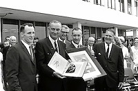 """Johnson Space Center , USA - June /14/1965 - File Photo - President Lyndon Johnson shows off photos of astronaut Edward H. White II during his historic """"space walk"""" extravehicular activity (EVA) on the Gemini 4 flight. Major participants from left to right are: Robert Gilruth (background) Ed White, President Lyndon Johnson, Robert Seamans, Jim McDivitt and James Webb."""