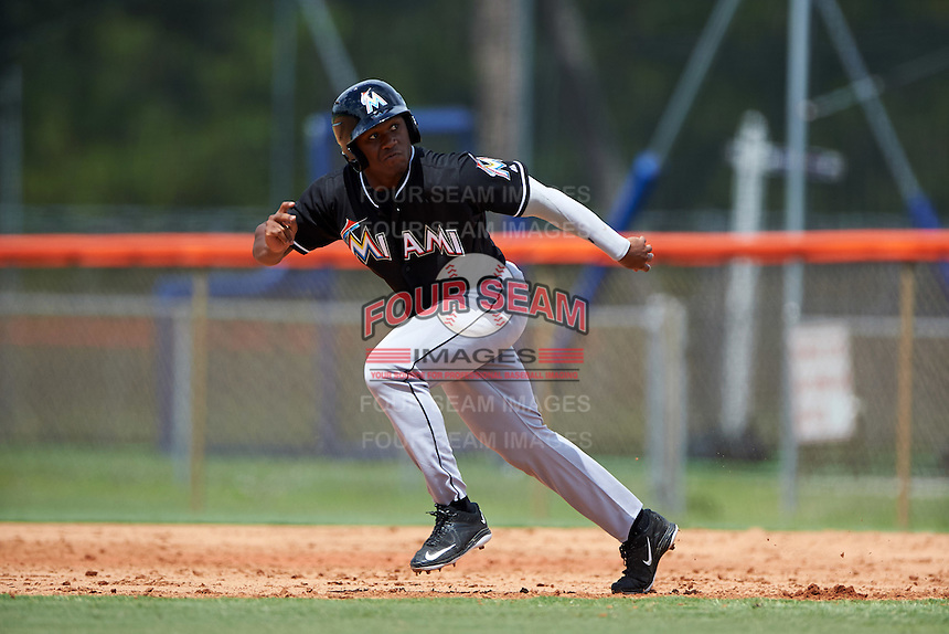 GCL Marlins pinch runner Terry Bennett (27) goes on a hit and run during the first game of a doubleheader against the GCL Mets on July 24, 2015 at the St. Lucie Sports Complex in St. Lucie, Florida.  GCL Marlins defeated the GCL Mets 5-4.  (Mike Janes/Four Seam Images)