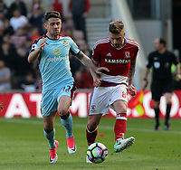 Burnley's Robbie Brady battles with Middlesbrough's Adam Clayton<br /> <br /> Photographer David Shipman/CameraSport<br /> <br /> The Premier League - Middlesbrough v Burnley - Saturday 8th April 2017 - Riverside Stadium - Middlesbrough<br /> <br /> World Copyright &copy; 2017 CameraSport. All rights reserved. 43 Linden Ave. Countesthorpe. Leicester. England. LE8 5PG - Tel: +44 (0) 116 277 4147 - admin@camerasport.com - www.camerasport.com