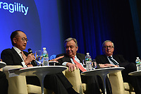 "Washington, DC - April 21, 2017: World Bank President Jim Yong Kim  speaks at the""Financing for Peace"" panel discussion during the annual Spring Meetings of the IMF/World Bank Group at the IMF headquarters in the District of Columbia April 21, 2017, as European Commission President Jean-Claude Juncker and United Nations Secretary General Antonio Guterres look on. (Photo by Don Baxter/Media Images International)"
