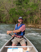 NWA Democrat-Gazette/FLIP PUTTHOFF <br /> Mike Mills of Ponca kneels in his canoe in this 2009 photo during a trip on the Buffalo National River. Kneeling makes a canoe more stable and minimizes tipping over.