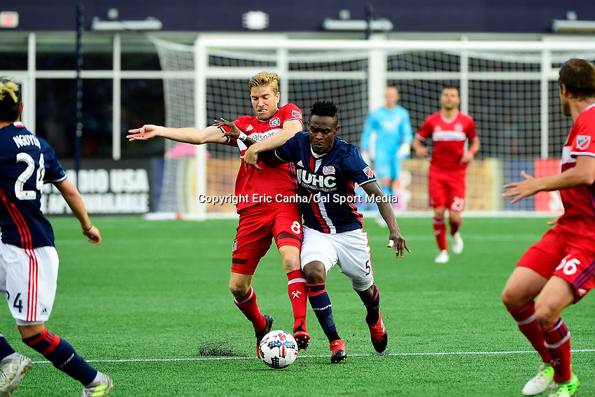 June 17, 2017: Chicago Fire midfielder Michael de Leeuw (8) and New England Revolution midfielder Gershon Koffie (5) battle for control of the ball during the MLS game between Chicago Fire and the New England Revolution held at Gillette Stadium in Foxborough Massachusetts. Eric Canha/CSM