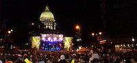 People watch the band at the Mountain Dew / State Capitol Stage during Freakfest 2015 on State Street in Madison, Wisconsin