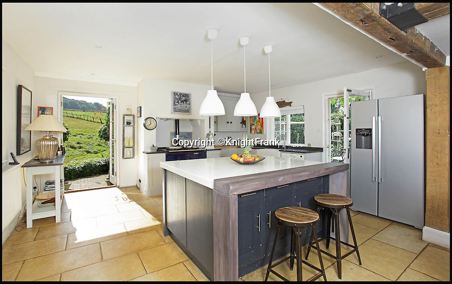 BNPS.co.uk (01202 558833)<br /> Pic: KnightFrank/BNPS<br /> <br /> The kitchen.<br /> <br /> The owners of this luxury property that has gone on the market can really tell nuisance callers to get lost - as it comes with its very own maze.<br /> <br /> Badsell Park Farm, near the village of Matfield, Kent, has 96 acres of land that includes the 8ft tall maze that covers an area of 12,000 sq ft.<br /> <br /> The 18th century property is valued at &pound;2.6million.