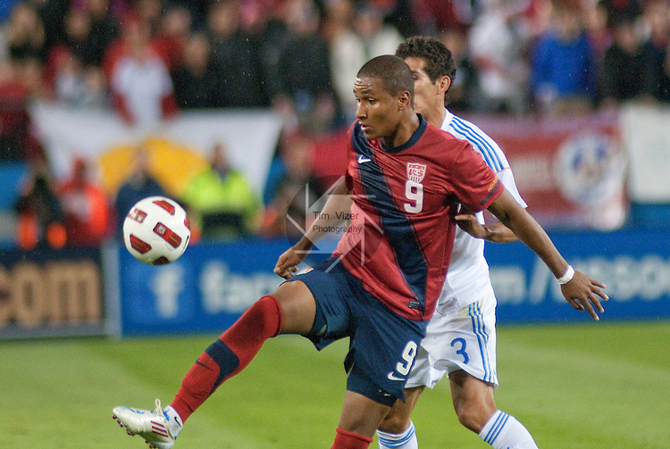 March 29,  2011      USA forward Juan Agudelo (9) controls the ball as it drops to him in the first half.  Behind him is Paraguay defender Marcos Cáceres (3).The USA Men's National Soccer Team played Paraguay in an international friendly game on Tuesday March 29, 2011 at LP Field in Nashville, Tennessee.