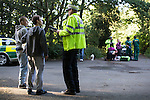 © Joel Goodman - 07973 332324 . 16 August 2013 . Manchester , UK . Friends of injured 15 year old (one of whom was also injured) talk to Inspector Bailey-Smith after the victim (being treated in the background) suffered a severe leg break in Wythenshawe Park following a motorbike crash . Drive along with Inspector Matt Bailey-Smith ( 16366 ) of Greater Manchester Police 's Serious Collision Unit . Photo credit : Joel Goodman