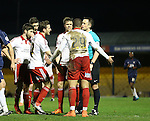 Sheffield United's players complain to referee Stuart Attwell after he awarded a freekick instead of a penalty during the League One match at Roots Hall Stadium.  Photo credit should read: David Klein/Sportimage