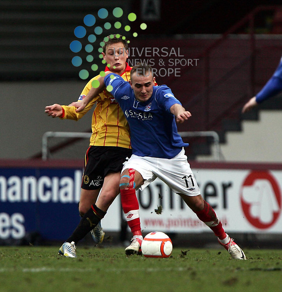 Partick Thistle v Cowdenbeath.Irn Bru 1st Division.Saturday 26th Jan 2013.Firhill Stadium -- Score 2-1.Scott Linton holds off the challenge of James Craigen.Photo by Tommy Taylor Universal News and Sport