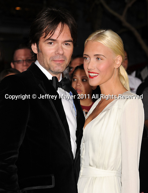 "LOS ANGELES, CA - NOVEMBER 14: Billy Burke and Pollyanna Rose arrive at the Los Angeles premiere of ""The Twilight Saga: Breaking Dawn Part 1"" held at Nokia Theatre L.A. Live on November 14, 2011 in Los Angeles, California."