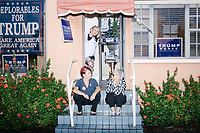 Blanca Vrotsos, 62, of Doral, Florida, (top), Zoila Oliva, 76, (right) and Inez Yimoc, 55, both of Hialeah, talk about what they think might happen if Trump doesn't win at the Donald Trump campaign office in Hialeah, Miami, Florida, on Sun., Oct. 9, 2016.  The three were volunteering in the campaign phone bank.