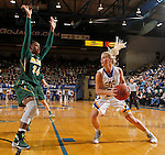 BROOKINGS, SD - FEBRUARY 6:  Chloe Cornemann #22 from South Dakota State looks to make a move past Brianna Jones #34 from North Dakota State Saturday afternoon at Frost Arena in Brookings. (Photo by Dave Eggen/Inertia)