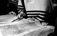 ROMANIA, Bucharest,  March of 2002..Reading the book of Esther for Purim celebration in Choral Temple in Bucharest. Only three synagogues still exist in Bucharest against 150 before the war.900,000 Jews lived in Romania before the war. They are now less than 12,000 in  Romania and 6000 in Bucharest. .ROUMANIE, Bucarest, Mars 2002..Lecture du livre d'Ester pour la célébration de Pourim au temple Choral de Bucarest. Seules trois synagogues existent encore à Bucarest contre 150  avant la guerre.900000 Juifs vivaient en Roumanie avant la guerre. Ils sont aujourd'hui moins de 12000 en Roumanie dont 6000 à Bucarest..© Bruno Cogez