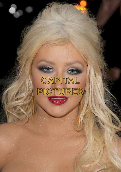 "CHRISTINA AGUILERA .""Burlesque"" Los Angeles Premiere held at Grauman's Chinese Theatre,Hollywood, California, USA, .15th November 2010..portrait headshot beauty red lipstick strapless  make-up eyeshadow .CAP/ADM/CH.©Charles Harris/AdMedia/Capital Pictures"