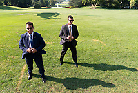 Secret Service agents brace themselves from windblast from Marine One as United States President Donald J. Trump and First lady Melania Trump depart the White House, August 7, 2019 to visit El Paso, TX and Dayton Ohio after recent shootings in those cities. <br /> CAP/MPI/RS<br /> ©RS/MPI/Capital Pictures