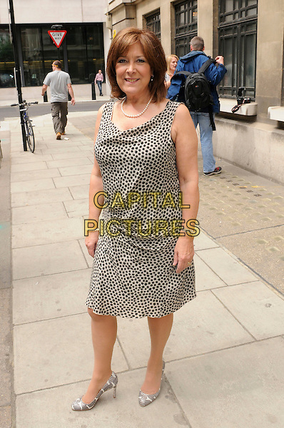 LYNDA BELLINGHAM.AT BBC Radio 2, London, England, UK, 17th 2011..full length white black cream print dress sleeveless  snake snakeskin shoes heels .CAP/IA.©Ian Allis/Capital Pictures.