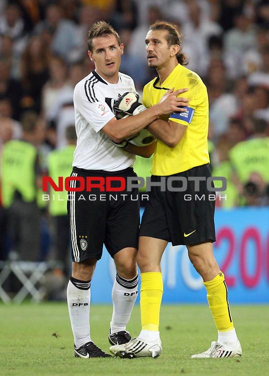 UEFA Euro 2008 Semi-Finals Match 29 Basel - St. Jakob-Park. Deutschland ( GER ) - T&uuml;rkei ( TUR ) 3:2 ( 1:1 ). <br /> Miroslav Klose ( Germany / Angreifer / Forward / Bayern Muenchen #11 ) (l) tr&ouml;stet R&uuml;st&uuml; Recber ( T&uuml;rkei / Torh&uuml;ter / Goalkeeper / Besiktas Istanbul #01 ) (r) bei Spielende.<br /> Foto &copy; nph (  nordphoto  )