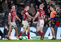 Picture by Allan McKenzie/SWpix.com - 08/09/2017 - Rugby League - Betfred Super League - The Super 8's - Hull FC v Wigan Warriors - KC Stadium, Kingston upon Hull, England - Wigan's Tom Davies is congratulated on scoring a try against Hull FC.