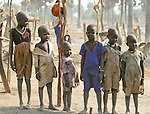 "These children are growing up in a Dinka cattle camp near Akot, South Sudan.  The Dinka are the majority ethnic group in South Sudan.  Pastoralist cattle.keepers, they traditionally live in ""cattle camps"" of hundreds or even thousands of cows."