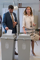 Janos Ader (L) president of Hungary and his wife Anita Herczegh (R) cast their votes during the European Parliamentary election in Budapest, Hungary on May 26, 2019. ATTILA VOLGYI
