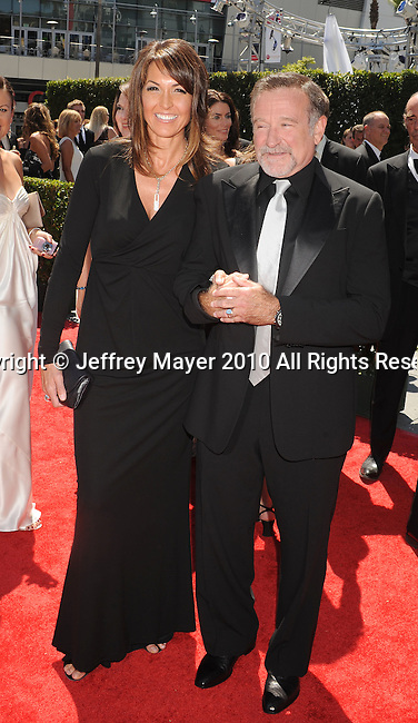 LOS ANGELES, CA. - August 21: Robin Williams (R) and Susan Schneider arrive at the 62nd Primetime Creative Arts Emmy Awards at Nokia Theatre LA Live on August 21, 2010 in Los Angeles, California.