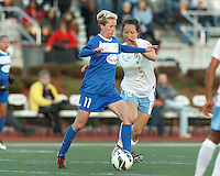 Boston Breakers midfielder Joanna Lohman (11) passes the ball as Chicago Red Stars defender Jackie Santacaterina (18) pressures. In a National Women's Soccer League Elite (NWSL) match, the Boston Breakers (blue) defeated Chicago Red Stars (white), 4-1, at Dilboy Stadium on May 4, 2013.