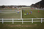 Edinburgh University 3 Selkirk 2, 13/03/2016. Peffermill, Scottish Lowland League. Home forward Jack Guthrie scores his team's second goal as Edinburgh University (in red) take on Selkirk in a Scottish Lowland League match at Peffermill, Edinburgh in a game the hosts won 3-2. The match was one of six attended by members of GroundhopUK over the weekend to accommodate groundhoppers, fans who attempt to visit as many football venues as possible. Around 100 fans in two coaches from England participated in the 2016 Lowland League Groundhop and they were joined by other individuals from across the UK which helped boost crowds at the six featured matches. Photo by Colin McPherson.