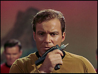 BNPS.co.uk (01202 558833)<br /> Pic: Propworx/BNPS<br /> <br /> ***Please Use Full Byline***<br /> <br /> Captain Kirk using the phaser gun in Star Trek.<br /> <br />  A super-rare prop gun from the original series of Star Trek has emerged for sale for a staggering &pound;40,000 almost 50 years after it first appeared on screen.<br /> <br /> The fibreglass prop, known as a phaser, is one of only two known to exist from the ground-breaking show which followed the adventures of William Shatner as maverick captain James T. Kirk and his crew on the starship Enterprise.<br /> <br /> Star Trek is now considered one of the greatest television programmes ever made, and original props demand a high price among its legion of fans around the world.<br /> <br /> The prop has been described as &quot;an incredible piece of television history&quot; and is tipped to fetch $60,000 - around &pound;40,000 - when it is auctioned at Propworx in Los Angeles.