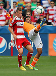 Houston Dynamo midfielder Giles Barnes (23) and FC Dallas defender Ugo Ihemelu (3) in action during the game between the FC Dallas and the Houston Dynamo at the FC Dallas Stadium in Frisco,Texas.
