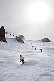 USA, California, Mammoth, skiers and snowboarders make their way down the hill at Mammoth Ski Resort