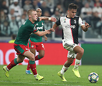 Football Soccer: UEFA Champions League -Group Stage-  Group D - Juventus vs Lokomotiv Moskva, Allianz Stadium. Turin, Italy, October 22, 2019.<br /> Juventus' Paulo Dybala (r) in action with Locomotiv Moskva's Dmitri Barinov (l) during the Uefa Champions League football soccer match between Juventus and Lokomotiv Moskva at Allianz Stadium in Turin, on October 22, 2019.<br /> UPDATE IMAGES PRESS