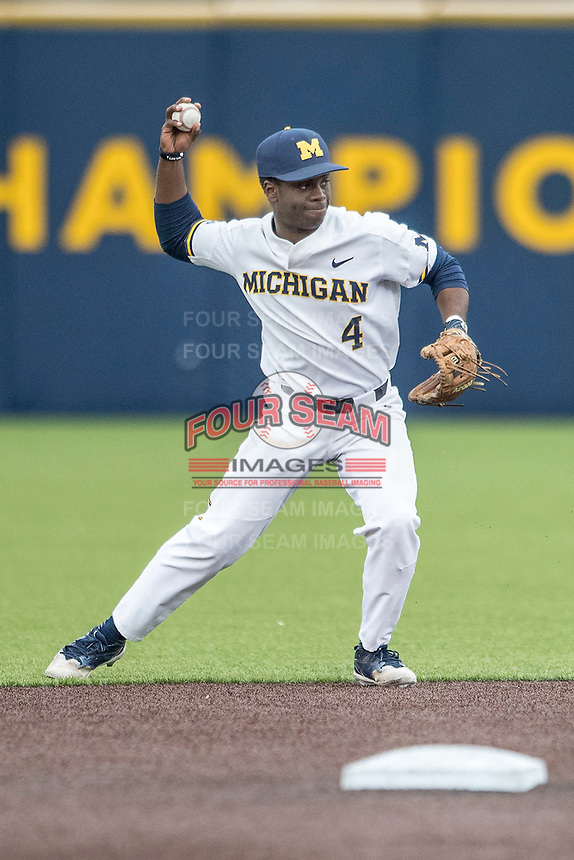 Michigan Wolverines second baseman Ako Thomas (4) makes a throw to first base against the Maryland Terrapins on April 13, 2018 in a Big Ten NCAA baseball game at Ray Fisher Stadium in Ann Arbor, Michigan. Michigan defeated Maryland 10-4. (Andrew Woolley/Four Seam Images)