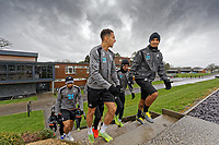 (L-R) Courtney Baker-Richardson and Kyle Naughton walk to the pitch during the Swansea City Training Session at The Fairwood Training Ground, in Swansea, Wales, UK. Wednesday 06 March 2019