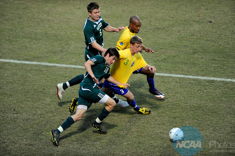 05 DEC 2009: Euan Purcell (14) and Sam Morris (3) of Fort Lewis battle for the ball with David Palmer (10) and Dale Parker (5) of Lees-McRae during the Division II Men's Soccer Championship held at Pepin Stadium on the Tampa University campus in Tampa, FL.  Fort Lewis defeated Lees-McRae 1-0 for the national title.  Stephen Nowland/NCAA Photos