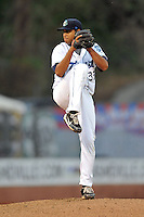 Asheville Tourists starting pitcher Jonathan Vargas #37 delivers a pitch during a game between the Hickory Crawdads and the Asheville Tourists at McCormick Field on April 17, 2013 in Asheville, North Carolina. The Crawdads won the game 6-5. (Tony Farlow/Four Seam Images).