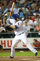 Round Rock Express catcher Dusty Brown #2 at bat during the MLB exhibition baseball game against the Texas Rangers on April 2, 2012 at the Dell Diamond in Round Rock, Texas. The Rangers out-slugged the Express 10-8. (Andrew Woolley / Four Seam Images).