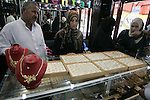 Palestinian women look at gold jewellery at a jewellery store in the Rafah Refugee Camp, Southern Gaza Strip on Sep. 10, 2011. Decline in demand for gold in the Palestinian markets due to the high price of $ 50 per gram, this high price in the global gold. Photo by Abed Rahim Khatib