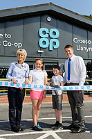 Lewis Eadys (3rd L) and Jasmine Hughes (2nd L) from year 6 of ysgol Rhys Pritchard cuts the ribbon with store manager Gethin Adams (R) and Sue Yelland (L)..