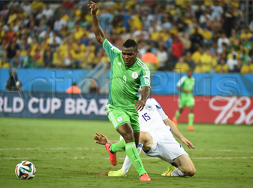 21.06.2014. Cuiaba, Brazil.  Nigerias Emmanuel Emenike (front)  with Bosnia and Herzegovinas Toni Sunjic during a Group F match between Nigeria and Bosnia and Herzegovina of 2014 FIFA World Cup at the Arena Pantanal Stadium in Cuiaba, Brazil, on June 21, 2014.