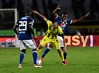 BOGOTA - COLOMBIA - 01 – 04 - 2018: Eliser Quiñones (Izq.) y Juan Salazar (Der.), jugadores de Millonarios disputan el balón con Jhon Perez (Cent.) jugador de Atletico Bucaramanga, durante partido de la fecha 12 entre Millonarios y por la Liga Aguila I 2018, jugado en el estadio Nemesio Camacho El Campin de la ciudad de Bogota. / Eliser Quiñones (L) and Juan Salazar (R), players of Millonarios vie for the ball with Jhon Perez (C) player of Atletico Bucaramanga, during a match of the 12th date between Millonarios and Atletico Bucaramanga, for the Liga Aguila I 2018 played at the Nemesio Camacho El Campin Stadium in Bogota city, Photo: VizzorImage / Luis Ramirez / Staff.