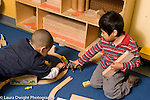Education Preschool 3-4 year olds two boys playing with train set and animal figures horizontal