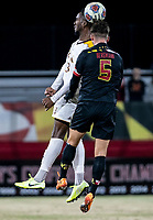 COLLEGE PARK, MD - NOVEMBER 21: Christian Geddes #3 of Iona heds away from Johannes Bergman #5 of Maryland during a game between Iona College and University of Maryland at Ludwig Field on November 21, 2019 in College Park, Maryland.