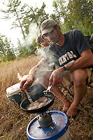Joe Chmelar and his son Crew cook dinner at their camp at High Rock Bay on the Keweenaw Peninsula during the 2010 U.P. Overland trip in the Upper Peninsula of Michigan.