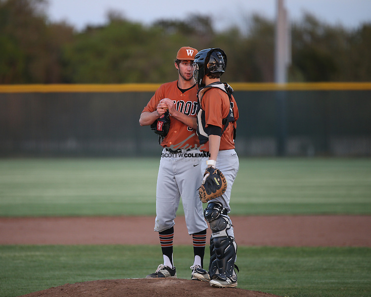 Westwood Warriors pitcher Christian Isenhour (3) and catcher Nick Williby (7) talk on the mound during a high school baseball game between Rouse High School and Westwood High School, at Rouse High School in Leander, Texas, on Tuesday, March 22, 2016.