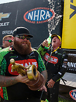 Sep 3, 2018; Clermont, IN, USA; NHRA top fuel driver Terry McMillen (right) celebrates with his crew after winning the US Nationals at Lucas Oil Raceway. Mandatory Credit: Mark J. Rebilas-USA TODAY Sports